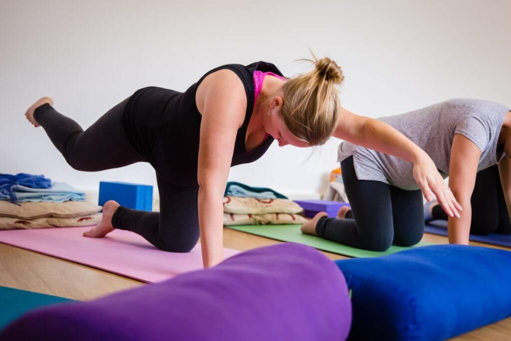 lady-with-head-down-in-a-yoga-position-on-a-mat